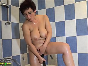 OldNanny black-haired mature showcases her panties