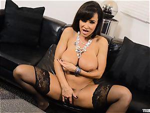 Lisa Ann thrusts her dildo deep in her moist vulva