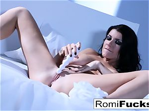 Solo joy on the bed with the big-chested sex industry star Romi Rain