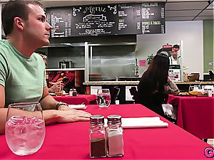 Melissa Moore gets a bone kebab under the table at the local food joint
