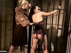 Kathia Nobili in wooly jacket torturing a warm babe