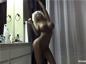 bare Nikita dries off after a luxurious shower