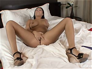 Pierced japanese London Keyes plays with her cunny in bed
