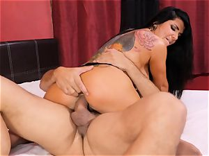 Romi Rain railing on a enormous wood