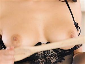 Valentina Nappi stimulates her cootchie in the kitchen